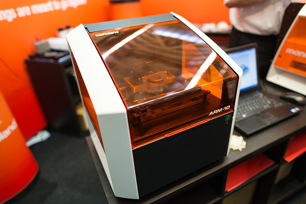 Roland announced this Arm 10 3D printer, which uses UV curing to create solid objects.